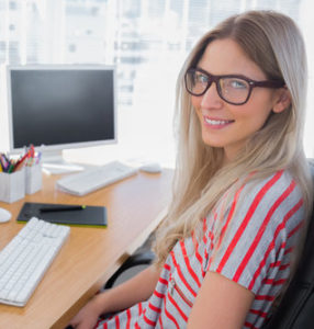 Woman with eyeglasses researching LASIK