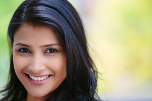 Young woman smiling after LASIK