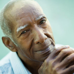 Elderly man smiling after Glaucoma treatment