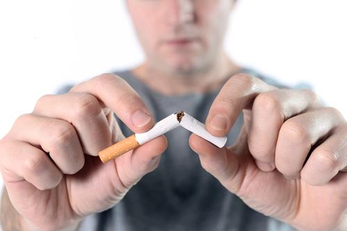 Guy breaking cigaretta in half