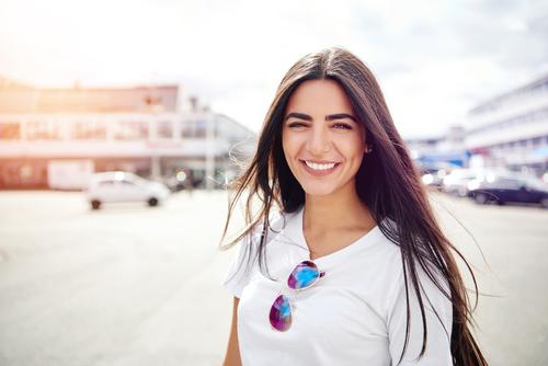 Lady wearing white shirt looking at camera.