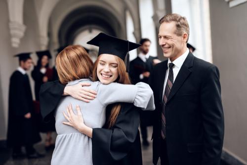Recent College Grad Hugging Parents after LASIK