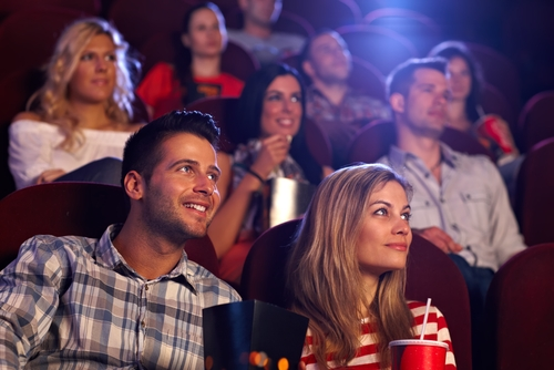 Young couple watching a movie after LASIK eye surgery